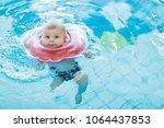cute little baby child learning ... | Shutterstock . vector #1064437853