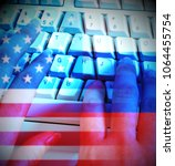 Small photo of Programmer Typing And Russia Usa Flags Shows Hacking. American Democratic Political Campaign Hacked By Online Cyber Criminals.