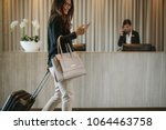 woman using mobile phone and... | Shutterstock . vector #1064463758
