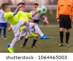 young children players match on ... | Shutterstock . vector #1064465003