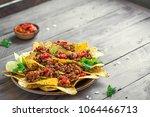 mexican nacho corn tortilla... | Shutterstock . vector #1064466713