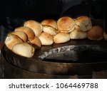 freshly baked buns just out of...   Shutterstock . vector #1064469788