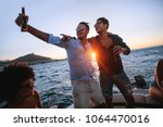 men having a great time at boat ... | Shutterstock . vector #1064470016