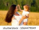 mom and daughter walking in the ... | Shutterstock . vector #1064479049