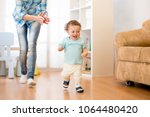 baby toddler have a fun running ... | Shutterstock . vector #1064480420