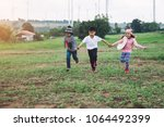 group of asian kids running in... | Shutterstock . vector #1064492399