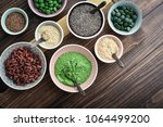 different super foods in bowls... | Shutterstock . vector #1064499200