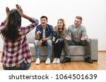 the four friends fun on the... | Shutterstock . vector #1064501639