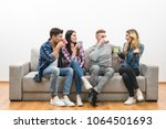 the four happy friends with... | Shutterstock . vector #1064501693