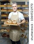 baker. a handsome baker with a... | Shutterstock . vector #1064521970