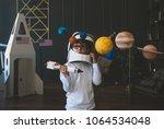 cute little boy wearing...   Shutterstock . vector #1064534048