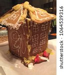 Small photo of Screw up Awry Gingerbread House fail broken roof hand made by marzipan and caramel frosting bad season sweets