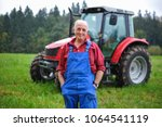 proud farmer standing in front... | Shutterstock . vector #1064541119