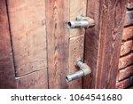 vintage wooden doors  | Shutterstock . vector #1064541680