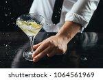 expert barman making cocktail... | Shutterstock . vector #1064561969