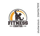 fitness logo badge with muscle... | Shutterstock .eps vector #1064567999