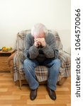 a sad sick old man in an... | Shutterstock . vector #1064570066
