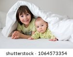 cute little six month old baby... | Shutterstock . vector #1064573354