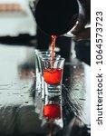 bartender pouring strong... | Shutterstock . vector #1064573723
