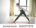 yoga girl sports hall   sport... | Shutterstock . vector #1064577878