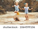 happy funny sisters twins ... | Shutterstock . vector #1064599106
