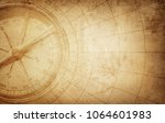 old vintage retro compass on... | Shutterstock . vector #1064601983