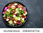 fresh vegetable salad with...   Shutterstock . vector #1064616716