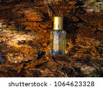 arabian perfumes on the... | Shutterstock . vector #1064623328