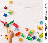 top view on child's hands... | Shutterstock . vector #1064630576