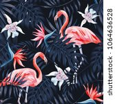 Stock vector tropical birds pink flamingo exotic flowers bird of paradise strelitzia dark blue palm leaves 1064636528