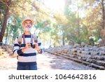 enjoying travel. senior smiling ... | Shutterstock . vector #1064642816