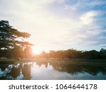beautiful sunrise in the park... | Shutterstock . vector #1064644178