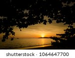 beautiful sunset on tropical... | Shutterstock . vector #1064647700