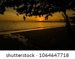 beautiful sunset on tropical... | Shutterstock . vector #1064647718