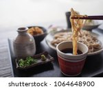 japanese soba noodle dipping in ... | Shutterstock . vector #1064648900