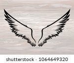 wings. vector illustration on... | Shutterstock .eps vector #1064649320