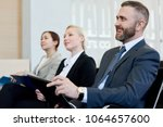 group of smiling business... | Shutterstock . vector #1064657600