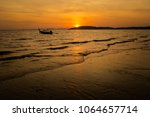 beautiful sunset on tropical... | Shutterstock . vector #1064657714