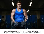 handsome young fit muscular... | Shutterstock . vector #1064659580