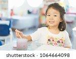 portrait of adorable little... | Shutterstock . vector #1064664098