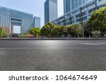 empty road with modern business ... | Shutterstock . vector #1064674649