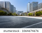empty road with modern business ... | Shutterstock . vector #1064674676