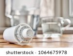 cartridge of a water filter... | Shutterstock . vector #1064675978