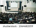 speaker at business conference... | Shutterstock . vector #1064682059