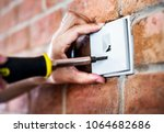 closeup of switch installation... | Shutterstock . vector #1064682686