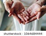 top view wedding rings in the... | Shutterstock . vector #1064684444