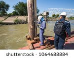 male worker inspection and... | Shutterstock . vector #1064688884