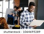 happy young black it specialist ...   Shutterstock . vector #1064695289