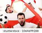 happy male friends cheering and ... | Shutterstock . vector #1064699288