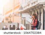 young beautiful female traveler ... | Shutterstock . vector #1064702384